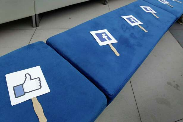 Facebook is bringing its Facebook Community Boost program to Houston April 3-6. Pictured are signs with Facebook icons placed on benches for attendees of a conference for small business owners at Facebook's headquarters in Menlo Park, Calif. on Tuesday, Aug. 5, 2014.