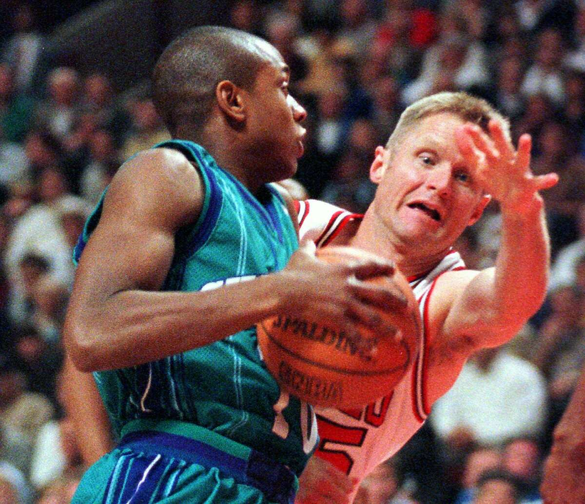 Chicago Bulls' Steve Kerr (25) tries to knock the ball away from Charlotte Hornets' B.J. Armstrong (10) during the first quarter of the Eastern Division Conference semifinal game Wednesday, May 6, 1998, in Chicago. (AP Photo/Beth A. Keiser) HOUCHRON CAPTION (05/07/1998): Charlotte's B.J. Armstrong, making a move against Steve Kerr, was a driving force as the Hornets surprised the Bulls 78-76 Wednesday night to even their series. Armstrong burned his former team for eight points in the fourth quarter as Charlotte overcame an eight-point deficit.