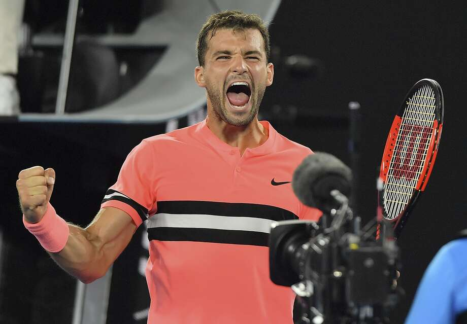 Grigor Dimitrov exults after defeating American Mackenzie McDonald in their second round match. Photo: Andy Brownbill, Associated Press