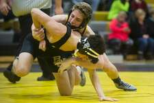 Bullock Creek's Brandon Fowler, bottom, wrestles Standish-Sterling's Dylan Kolbiaz during a meet on Wednesday, Jan. 17, 2018 at Bullock Creek High School. (Katy Kildee/kkildee@mdn.net)