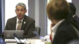 San Antonio Mayor Ron Nirenberg, left, listens during a recent meeting. He has proposed an independent research entity for the City Council; the council should make this happen.