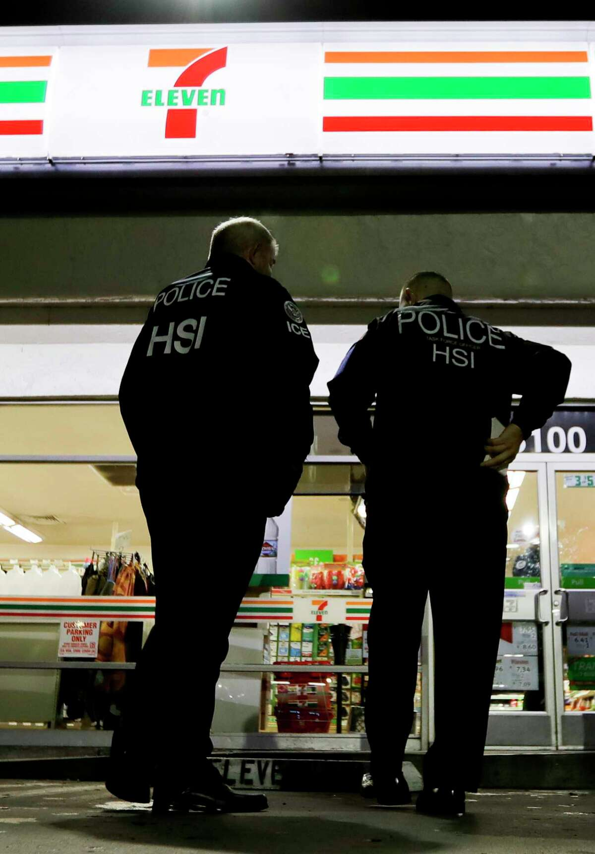 U.S. Immigration and Customs Enforcement agents serve an employment audit notice at a 7-Eleven in Los Angeles on Jan. 10.