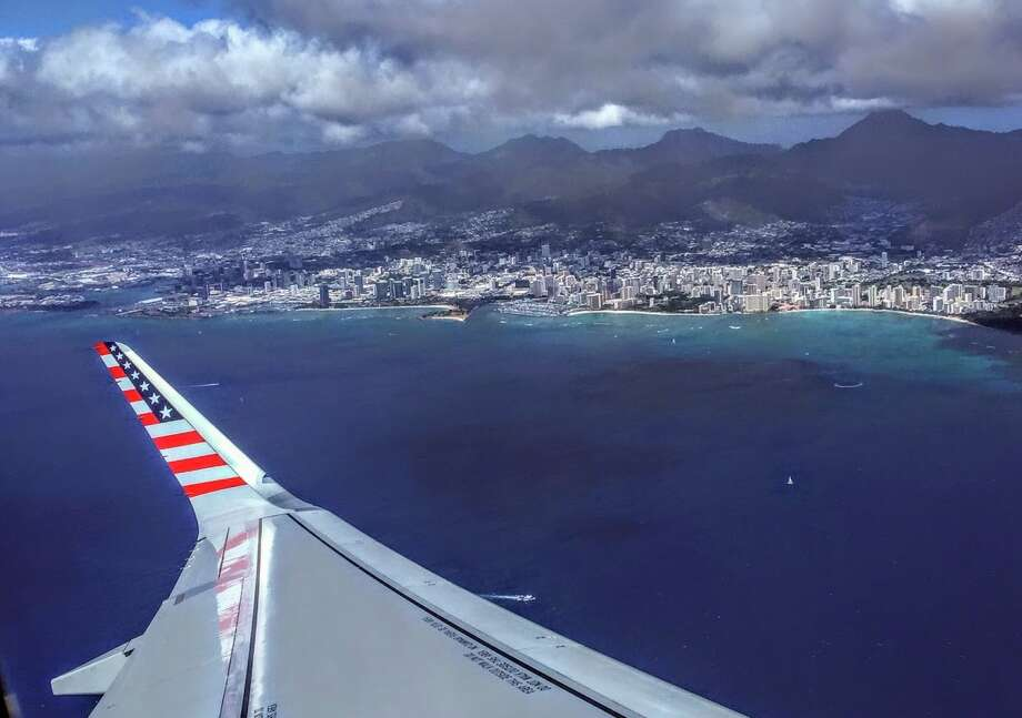 Virgin America's flashy brand and American flag wingtips will start to fade away in April. Pictured here: A Virgin America Airbus A321 taking off from Honolulu enroute to SFO Photo: Chris McGinnis