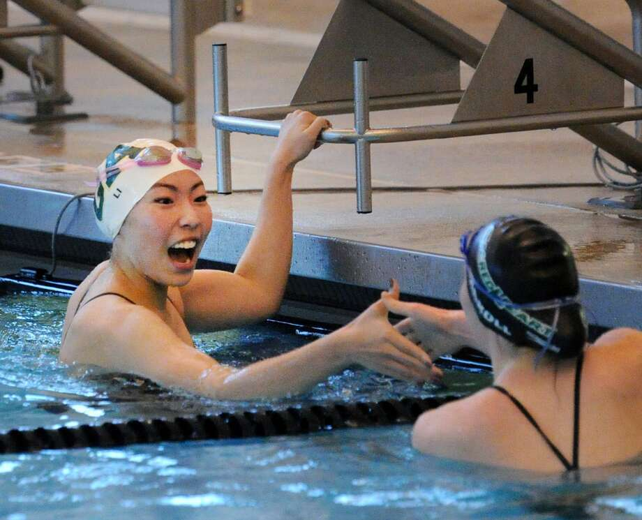 After winning the 50 freestyle event, GA swimmer Christina Li, left, shakes hands with Sacred Heart Greenwich swimmer Kalyna Carroll during the girls high school swim meet between Greenwich Academy and Sacred Heart Greenwich at Brunswick School in Greenwich, Conn., Wednesday, Feb. 1, 2017. Photo: Bob Luckey Jr. / Hearst Connecticut Media / Greenwich Time