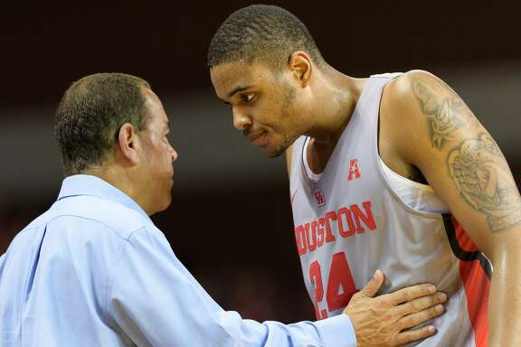 Houston Cougars Head Coach, Kelvin Sampson coaches Breaon Brady (24) after he comes off the court in the second half against the Arkansas Razorbacks in a college basketball game on Saturday, December 2, 2017 at H&PE Arena in Houston Texas.