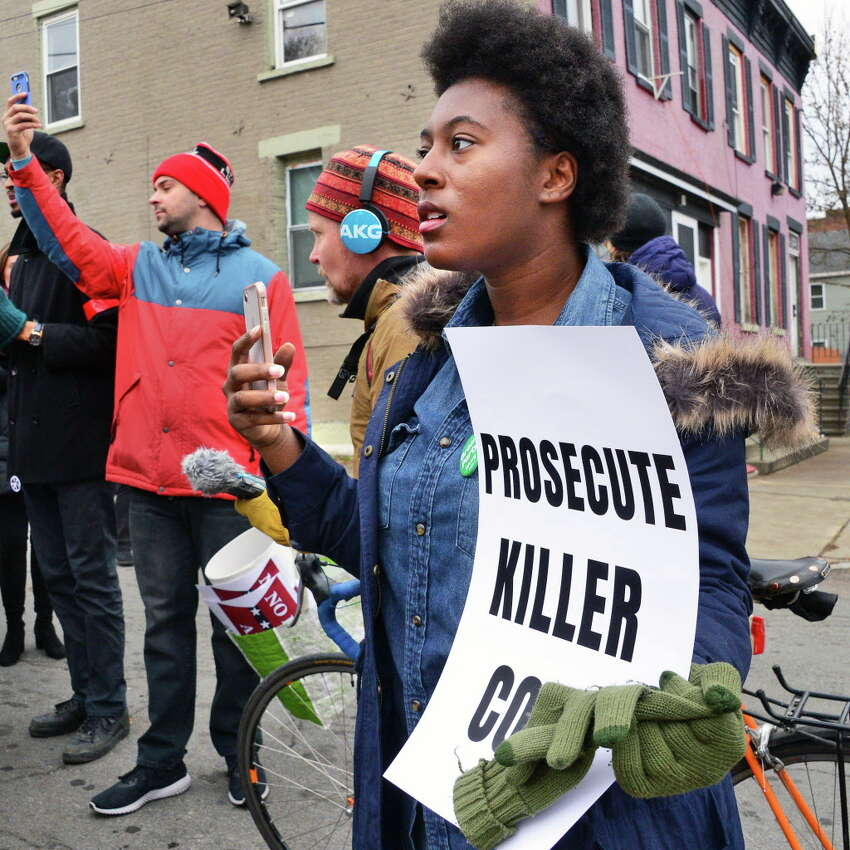 Green Party member Tatianna Moragne of Watervliet attends a rally to draw attention to the police killing of Edson Thevenin and shooting of Dahmeek McDonald and to call for the use of a civilian review board Saturday Nov. 18, 2017 in Troy, NY. (John Carl D'Annibale / Times Union)