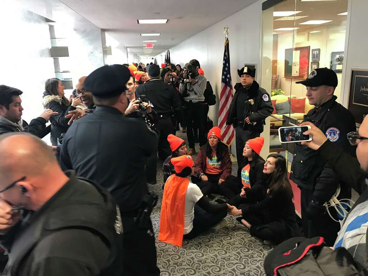 Five protesters were arrested outside the office of U.S. Sen. John Cornyn, R-Texas, while dozens of others were arrested at other senators' offices. The protestors were pushing for a bill that would codify an Obama-era executive order protecting certain young immigrants from deportation.
