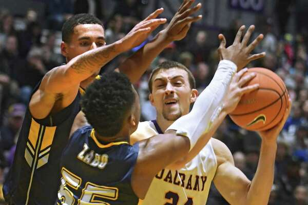 University at Albany's Joe Cremo looks for an open man during a basketball game against Kent State at SEFCU Arena on Thursday, Dec. 28, 2017 in Albany, N.Y.  (Lori Van Buren / Times Union)
