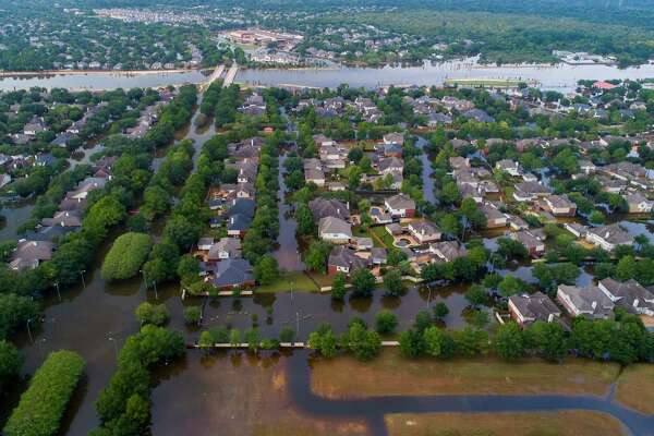 The Canyon Gate neighborhood of Cinco Ranch, right, was filled last September by flood water from Barker Reservoir.