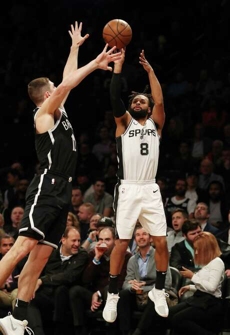 NEW YORK, NY - JANUARY 17:  San Antonio Spurs guard Patty Mills #8 shoots against Brooklyn Nets guard Joe Harris #12 during their game at The Barclays Center on January 17, 2018 in New York City.   User expressly acknowledges and agrees that, by downloading and/or using this Photograph, user is consenting to the terms and conditions of the Getty Images License Agreement. Photo: Al Bello, Getty Images / 2018 Getty Images