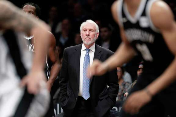 San Antonio Spurs head coach Gregg Popovich watches his team play during the first half of an NBA basketball game against the Brooklyn Nets Wednesday, Jan. 17, 2018, in New York. (AP Photo/Frank Franklin II)