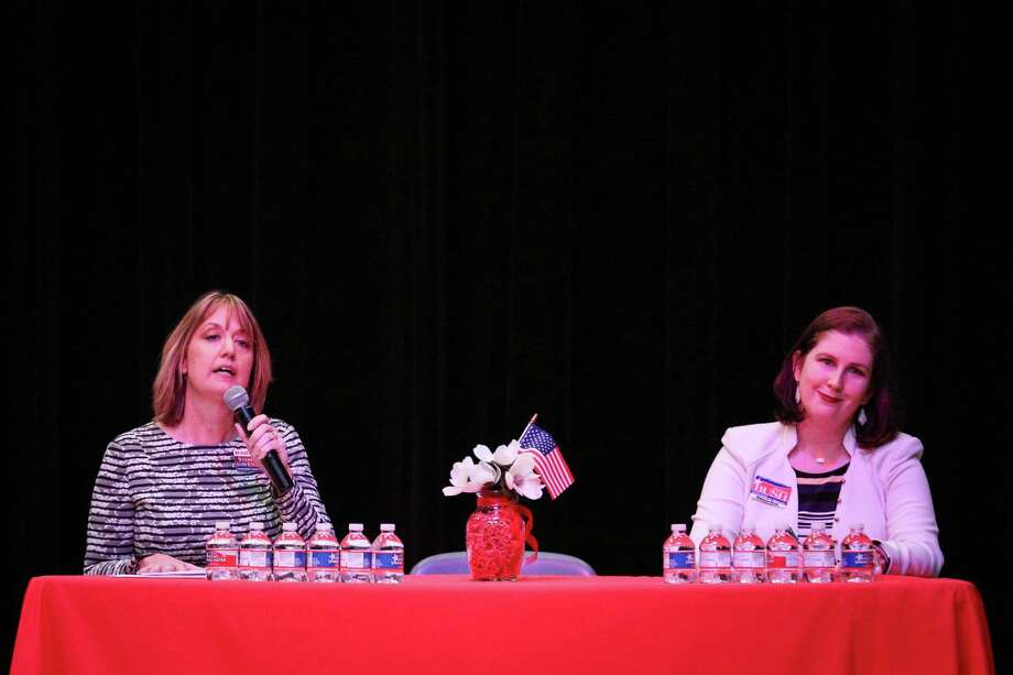 Incumbent Stephanne Davenport, left, and candidate Melanie Bush, both running for Montgomery County Treasurer, debate during the Public Republican Candidate Forum hosted by Magnolia Area Republican Women on Monday, Jan. 15, 2018, at Magnolia Parkway Elementary. Photo: Michael Minasi, Staff Photographer / © 2017 Houston Chronicle