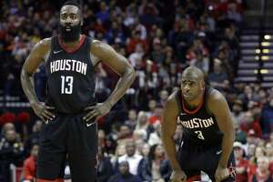Houston Rockets guard James Harden (13) and guard Chris Paul (3) in the second half of an NBA basketball game against the Los Angeles Lakers Sunday, Dec. 31, 2017, in Houston. (AP Photo/Michael Wyke)