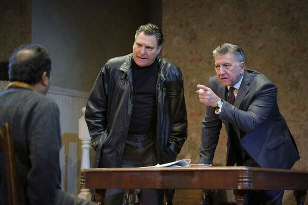 """McCann (Marco Barricelli, center) and Goldberg (Scott Wentworth, right) interrogate Stanley (Firdous Bamji, left) in ACT's """"The Birthday Party."""""""