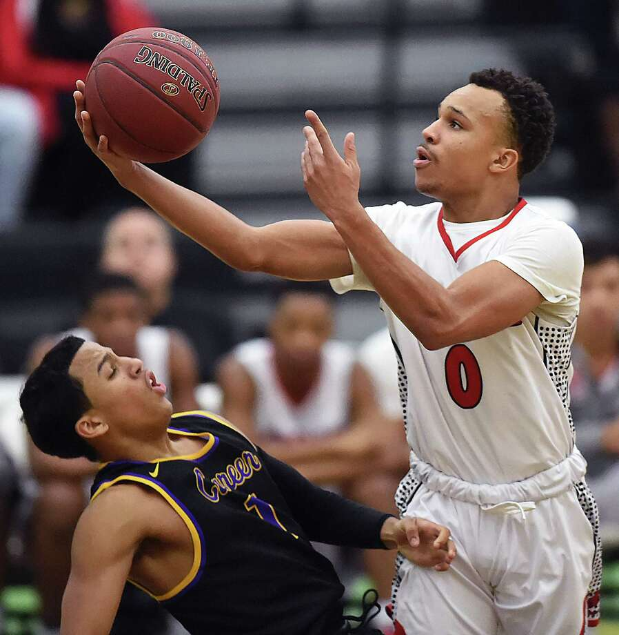 Wilbur Cross' Twane Taylor elevates for a shot against Career's Kyle Daniels, Wednesday, Jan. 17, 2018, at Floyd Little Athletic Center in New Haven. Taylor was called for an offensive charge. Wilbur Cross won, 57-50. Photo: Catherine Avalone, Hearst Connecticut Media / New Haven Register