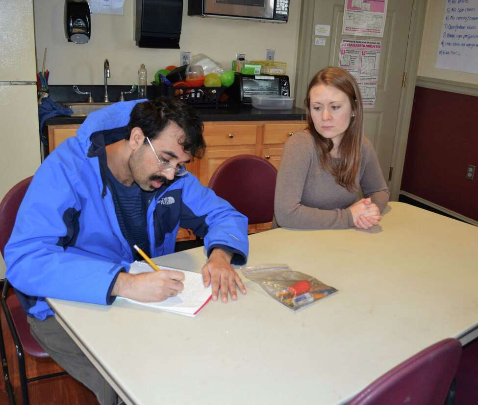 Kristina Collins, Schenectady ARC Discovery Academy program coordinator, works with student Rahman Khan. (Submitted photo)