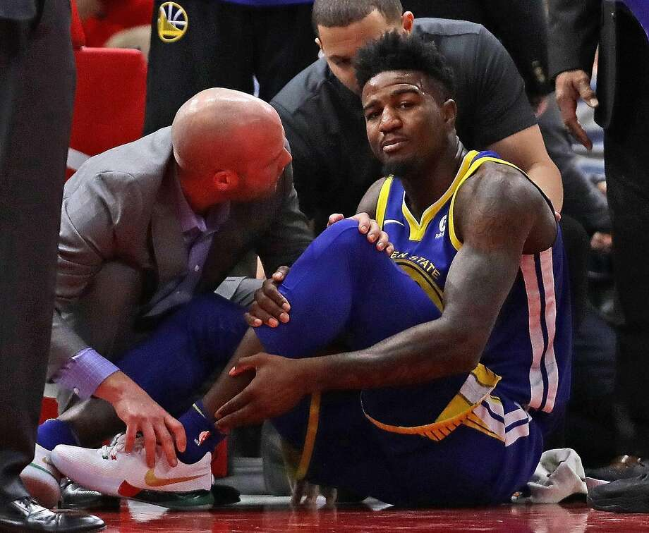 CHICAGO, IL - JANUARY 17:  Jordan Bell #2 of the Golden State Warriors is attended to after suffering a leg injury on the first play of the game against the Chicago Bulls at the United Center on January 17, 2018 in Chicago, Illinois. NOTE TO USER: User expressly acknowledges and agrees that, by downloading and or using this photograph, User is consenting to the terms and conditions of the Getty Images License Agreement.  (Photo by Jonathan Daniel/Getty Images) Photo: Jonathan Daniel, Getty Images