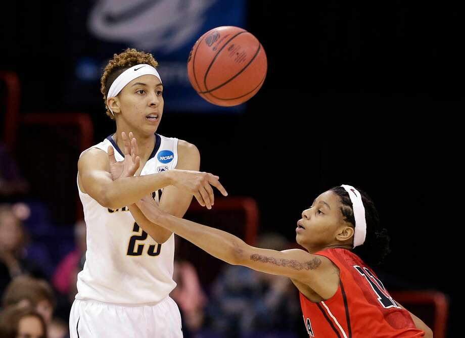 Cal's Layshia Clarendon, left, passes in front of Georgia's Tiaria Griffin in a 2013 NCAA regional final game in Spokane. Photo: Elaine Thompson, Associated Press