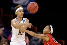 California's Layshia Clarendon, left, passes in front of Georgia's Tiaria Griffin during the first half in a regional final in the NCAA women's college basketball tournament, Monday, April 1, 2013, in Spokane, Wash. (AP Photo/Elaine Thompson)
