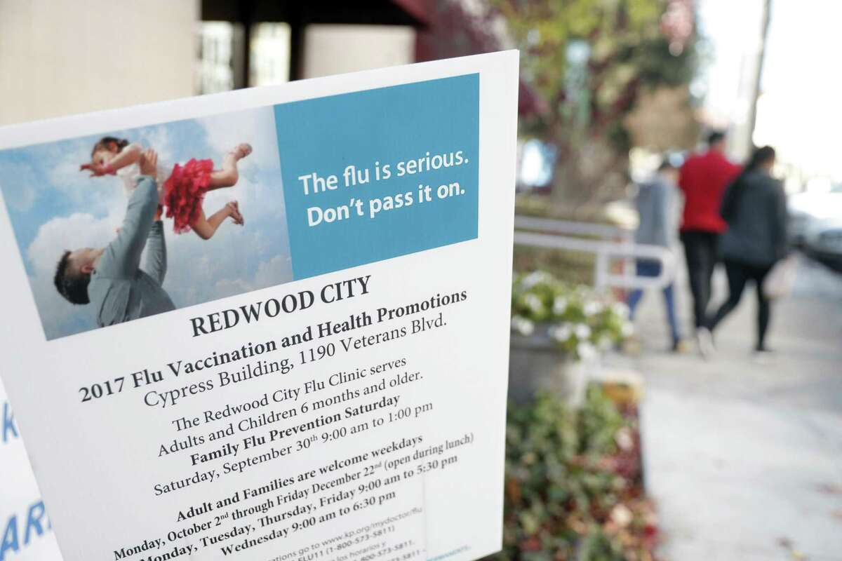A sign encouraging getting a flu vaccine at the Kaiser Permanente Redwood City hospital in Redwood City, Calif., on Thursday, December 28, 2017.
