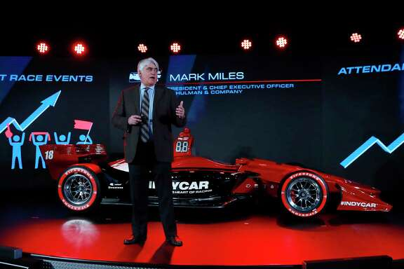 Mark Miles, president and CEO of Hulman & Company, describes the advantages of a new race car setup during the North American International Auto Show, Tuesday, Jan. 16, 2018, in Detroit. (AP Photo/Carlos Osorio)