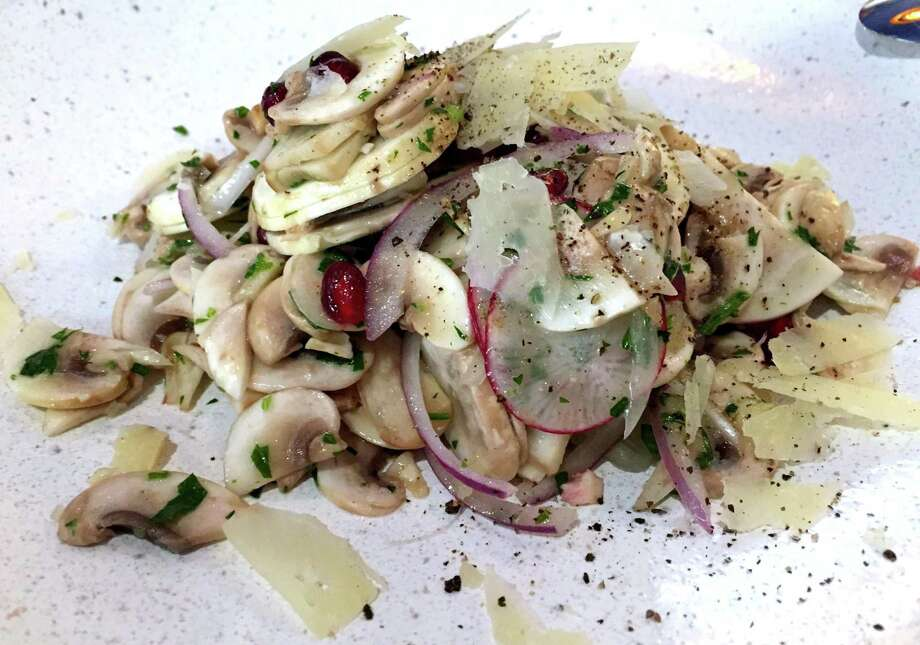 Clementine coaxes big flavor out of humble ingredients in this White Mushroom Salad. Photo: Paul Stephen / San Antonio Express-News