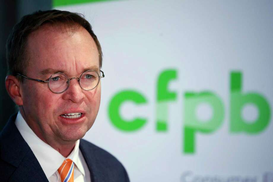 FILE - In this Monday, Nov. 27, 2017, file photo, Mick Mulvaney speaks during a news conference after his first day as acting director of the Consumer Financial Protection Bureau in Washington. Mulvaney said Wednesday, Jan. 17, 2018, that he is launching a review of all the federal consumer watchdog agency's policies and priorities. (AP Photo/Jacquelyn Martin, File) Photo: Jacquelyn Martin, STF / Copyright 2017 The Associated Press. All rights reserved.
