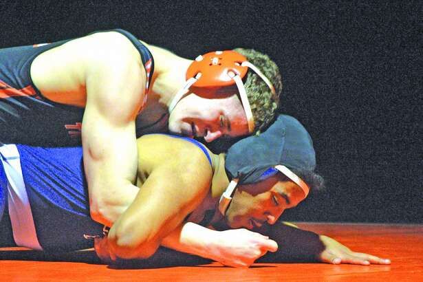 Edwardsville senior Riley Scheffel, top, wrestles Belleville East's Carlos Tyse during a 182-pound match on Wednesday at EHS.