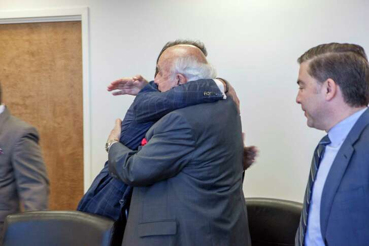 Energy Secretary Rick Perry embraces Robert Murray, a coal industry executive, at a meeting in Washington.