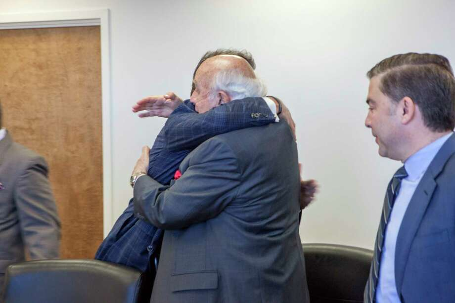 Energy Secretary Rick Perry embraces Robert Murray, a coal industry executive, at a meeting in Washington. Photo: SIMON EDELMAN, HO / DEPARTMENT OF ENERGY