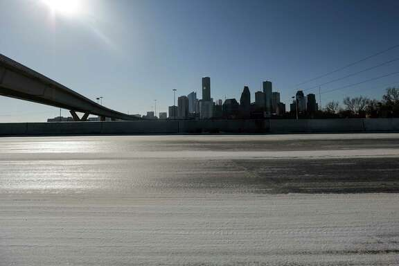 Ice and snow keep Crockett Street slick despite the sunshine in Houston on Wednesday, Jan. 17, 2018.( Elizabeth Conley/Houston Chronicle via AP)