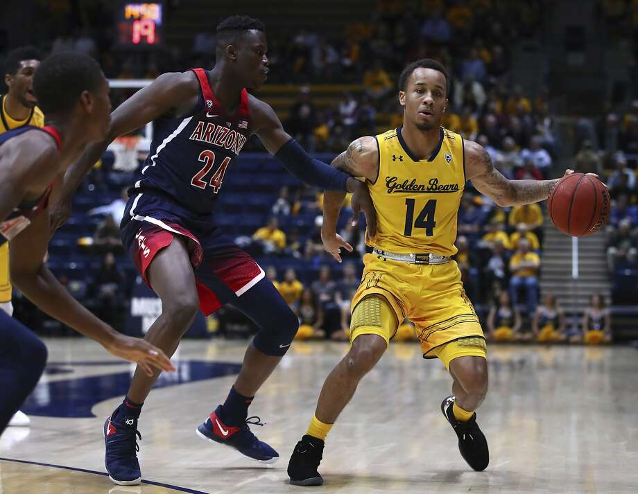 Arizona's Emmanuel Akot (24) defends against California's Don Coleman (14) in the first half of an NCAA college basketball game Wednesday, Jan. 17, 2018, in Berkeley, Calif. Photo: Ben Margot, Associated Press