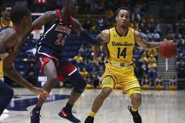 Arizona's Emmanuel Akot (24) defends against California's Don Coleman (14) in the first half of an NCAA college basketball game Wednesday, Jan. 17, 2018, in Berkeley, Calif. (AP Photo/Ben Margot)