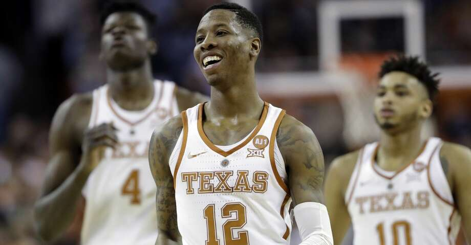 Texas guard Kerwin Roach II (12) smiles as he runs up court during final seconds of the second half of an NCAA college basketball game against Texas Tech, Wednesday, Jan. 17, 2018, in Austin, Texas. Texas won 67-58. (AP Photo/Eric Gay) Photo: Eric Gay/Associated Press