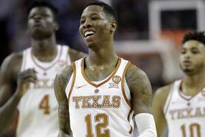 Texas guard Kerwin Roach II (12) smiles as he runs up court during final seconds of the second half of an NCAA college basketball game against Texas Tech, Wednesday, Jan. 17, 2018, in Austin, Texas. Texas won 67-58. (AP Photo/Eric Gay)