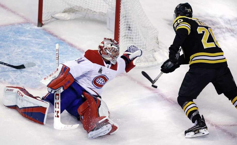 Bruins skate around Canadiens in Julien's return
