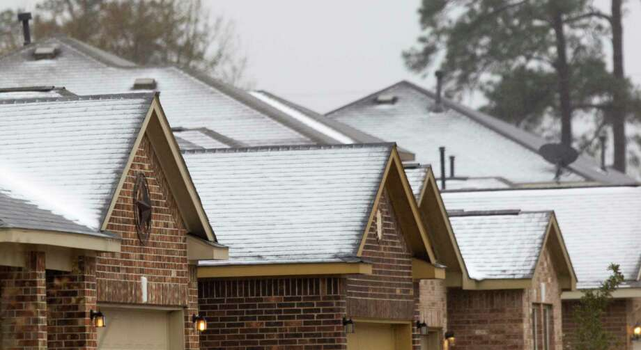 Ice forms on the roofs of homes in Porter as a winter storm brought freezing rain and ice throughout the greater Houston area, Tuesday, Jan. 16, 2018. The National Weather Service issued a Winter Storm Warning for southeast Texas until midnight Wednesday. Photo: Jason Fochtman, Staff Photographer / © 2018 Houston Chronicle