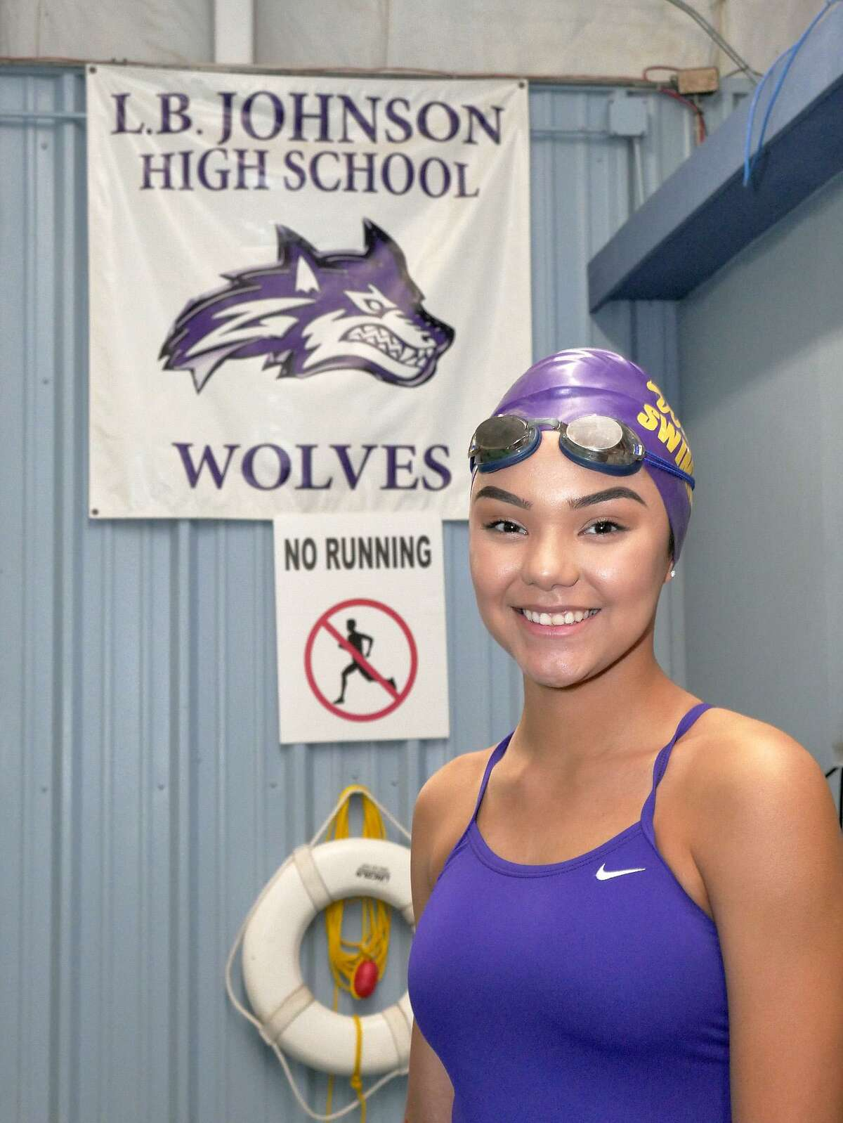 LBJ swimmer Astridt Gallegos has taken down numerous records in the pool this year as she hopes to begin her climb toward a state berth on Saturday at the District 29-6A meet in San Antonio.