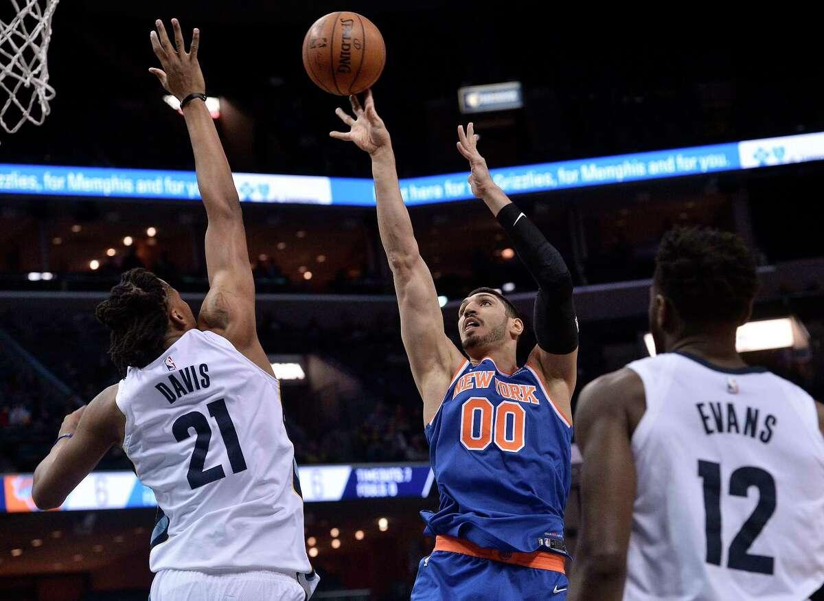 New York Knicks center Enes Kanter (00) shoots against Memphis Grizzlies center Deyonta Davis (21) in the first half of an NBA basketball game Wednesday, Jan. 17, 2018, in Memphis, Tenn. (AP Photo/Brandon Dill)