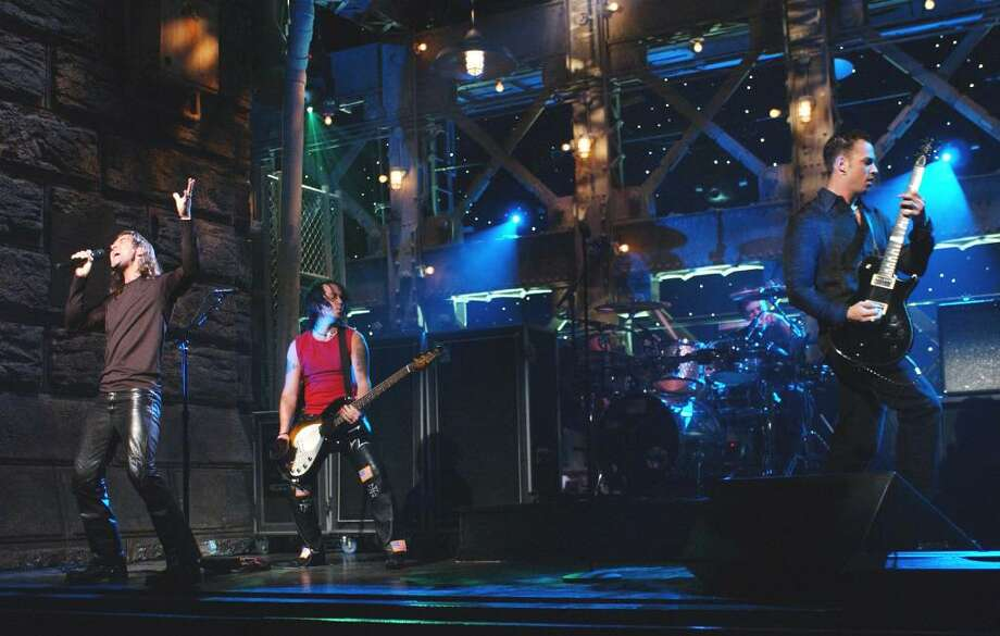 """The road has been a bumpy one for Creed since the band performed on """"Saturday Night Live"""" in 2001. Scott Stapp, bassist Brian Marshall, guitarist Mark Tremonti and drummer Scott Phillips will be at SPAC on Tuesday. Maryellen Mathews/Associated Press Archive)"""