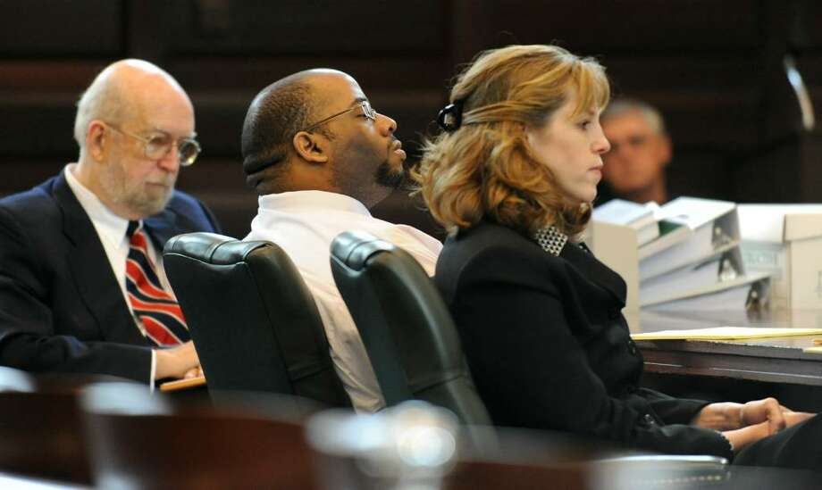 Murder defendant Adrian Thomas, center, listens to opening statements Friday with his defense attorneys Jerome Frost, left, and Ingrid Effman in Rensselaer County Court in Troy.  (Skip Dickstein / Times Union) Photo: SKIP DICKSTEIN