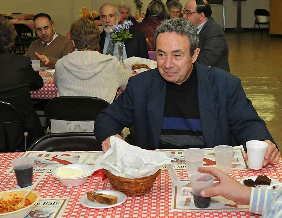 Assemblyman Ron Canestrari enjoys lunch at a pre-election day spaghetti dinner at St. Mary's church hall in Troy, NY on November 2, 2009. (Lori Van Buren / Times Union) Photo: LORI VAN BUREN