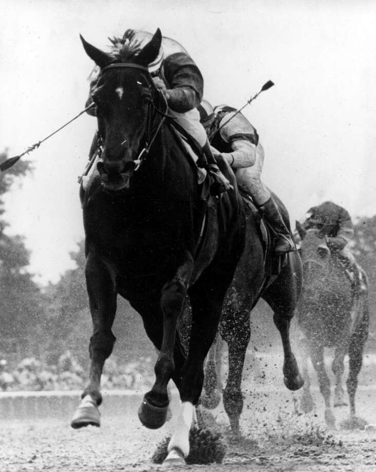 Jockey Jacinto Vasquez rides Ruffian over the finish line to win the Coaching Club American Oaks at Belmont Park race track in Elmont in this June 21, 1975, file photo. (Associated Press) / NYRA