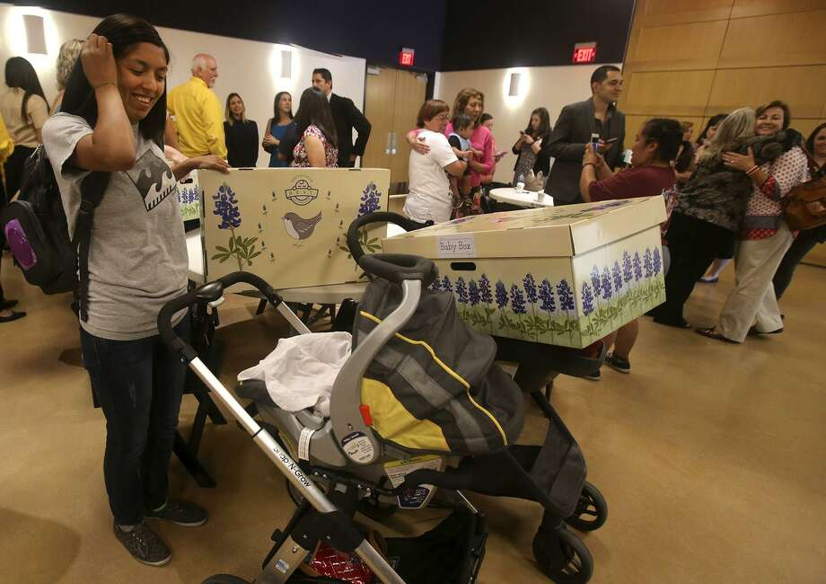 "To help prevent accidental deaths among infants, so-called ""baby boxes"" were donated to new and expectant mothers in May at the DoSeum. The boxes, made of cardboard and fitted with a foam mattress, promote safe sleeping habits for babies. The Centers for Disease Control and Prevention recommends that babies sleep on their backs on a mattress covered by only a fitted sheet, with no toys or other bedding. Accidental suffocation or strangulation in bed is the leading cause of accidental infant deaths in Texas, according to the Texas Department of State Health Services. Photo: John Davenport /San Antonio Express-News / ©San Antonio Express-News/John Davenport"