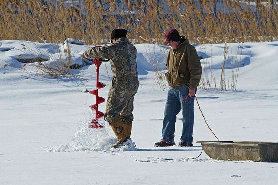 Ice fishing, as shown in this recent scene in the Thumb, could become an Olympic sport in the future. (Bill Diller/Hearst Michigan)