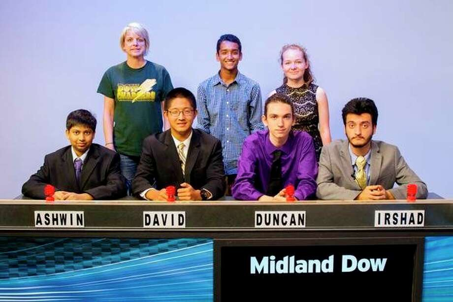 The H.H. Dow High quiz team, with coach Amy Bushey, poses for a photo. (Photo provided)
