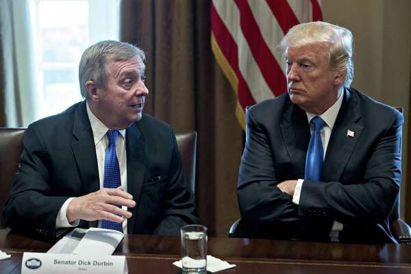 President Donald Trump (right), listens while Sen. Dick Durbin, D-Ill., speaks during a meeting with bipartisan members of Congress on immigration in the Cabinet Room of the White House in Washington on Jan. 9, 2018.
