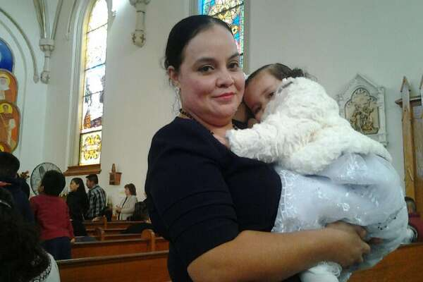 Maribel Trujillo Diaz poses with her daughter in church.