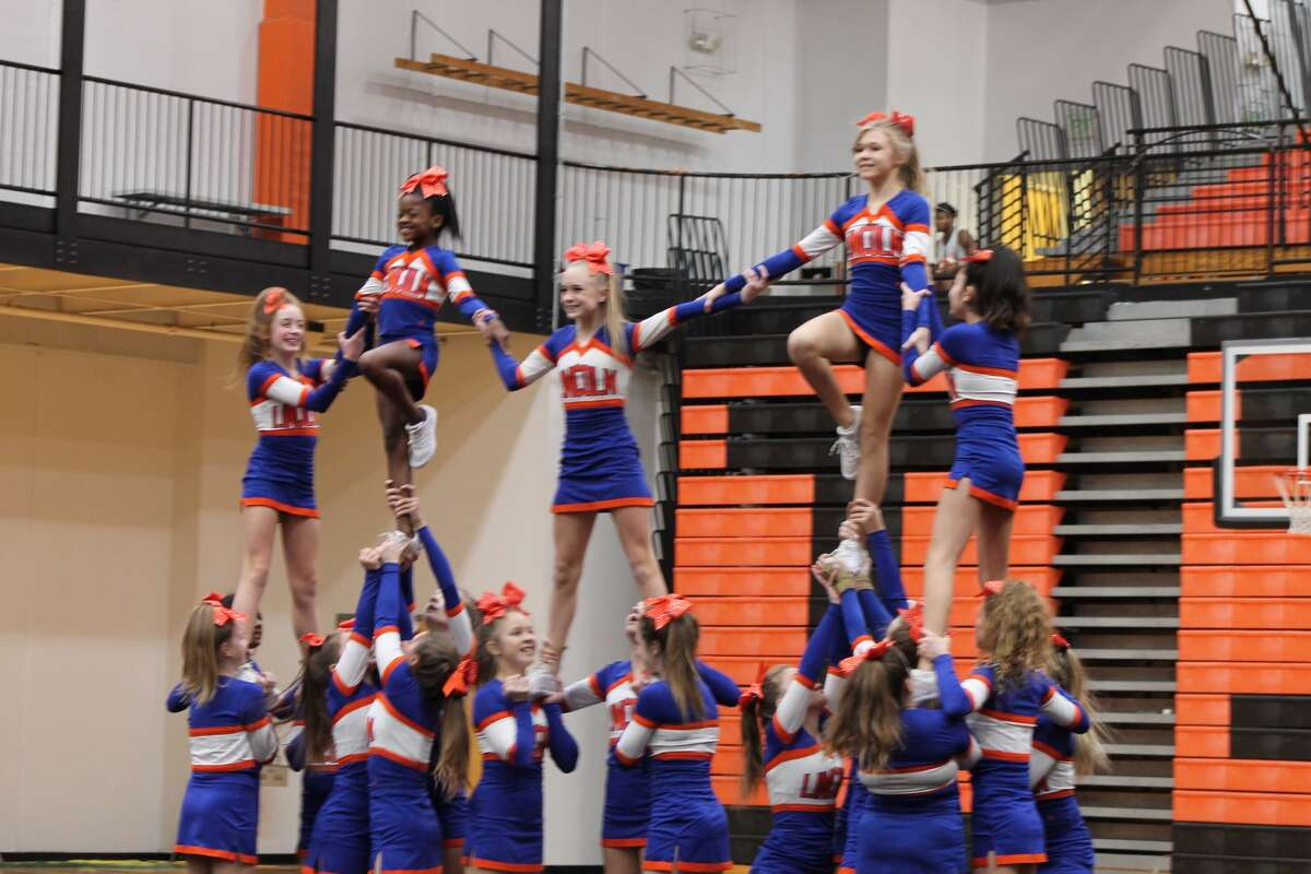 The Edwardsville High School varsity and junior varsity cheerleading squads, along with those from Lincoln and Liberty middle schools, conducted their annual exhibition Wednesday night in Lucco-Jackson Gymnasium at EHS. The event also serves to benefit Eden's Army, a non-profit that was created to help families at the Cardiac Intensive Care Unit at Children's Hospital in St. Louis. The mission is to give financial support to families whose children are in the care of CICU at the hospital. Those attending were asked to donate a toiletry to Eden's Army or make a cash donation.