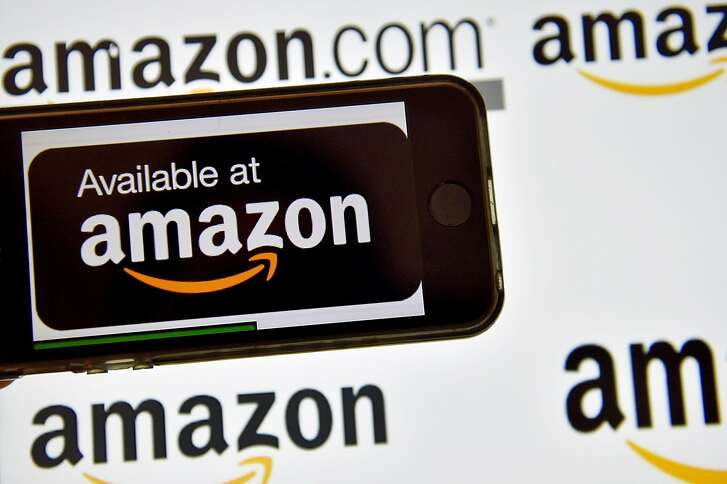 (FILES) This file photo taken on December 28, 2016 shows the logo of US electronic commerce and cloud computing company Amazon in Vertou, France. Amazon said January 18, 2018 it had narrowed to 20 its options for a second headquarters for the sprawling technology and lifestyle company headed by Jeff Bezos, the world's richest individual. After 238 cities from North America submitted bids, Amazon announced its short list included three in the vicinity of the US capital Washington, and the Canadian city of Toronto.  / AFP PHOTO / LOIC VENANCELOIC VENANCE/AFP/Getty Images